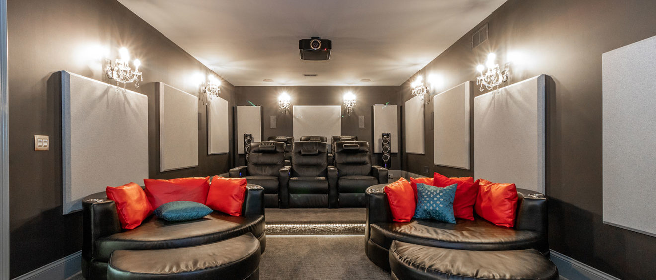 Beautiful Media Room with Tiered Theater Seating and Luxurious Leather Chairs Sound Deadening Acoustic Wall Panels Tower Speakers Projector Ground Mood Lighting Thomas Theater