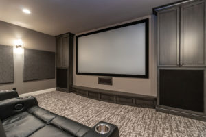 Media Room with Leather Recliner Theater Seating and Kitchenette withall Speakers and Wires Concealed Inside Custom Cabinets