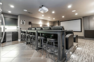 Media Room with Tiered Theater Seating, Leather Chairs and a Full Wet Bar Kitchenette. Sound Deadening Acoustic Panels. Invisible Speakers. Digital Projector. Theater Lighting.