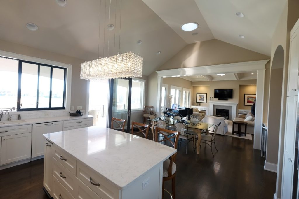 Flat-Screen TV on Kitchen Counter and High Quality Sound from Flush Mounted Speakers in the Ceiling by Pure Audio in Columbia Missouri