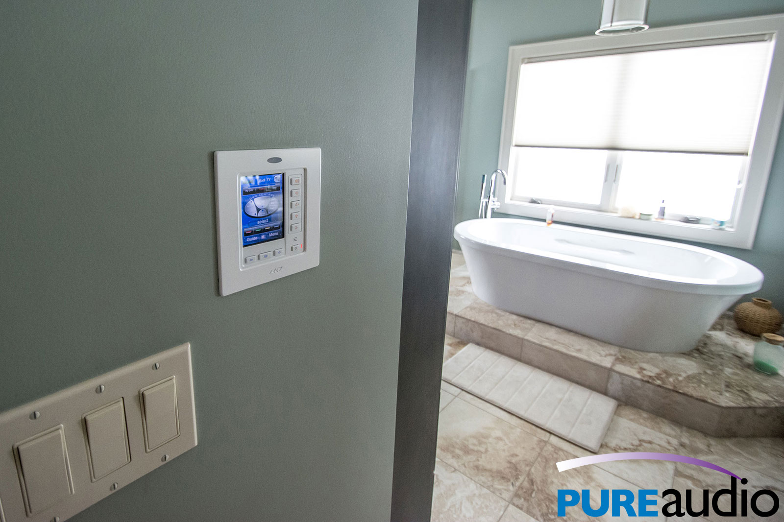 In-wall touch panel controls audio and video in home bathroom suite whole house automation with Pure Audio and Video in Columbia MO