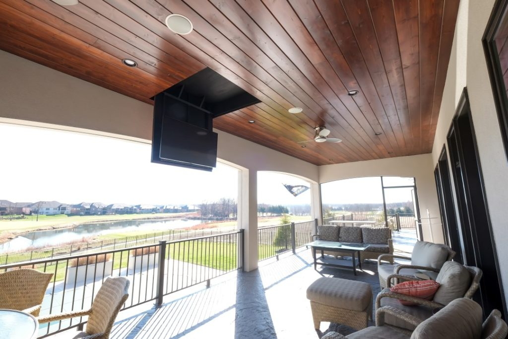 Retracting Television TV Recessed into Wood Paneled Ceiling with Motorized Mount on Exterior Outdoor Deck Patio Pure Audio CoMo Walek 102