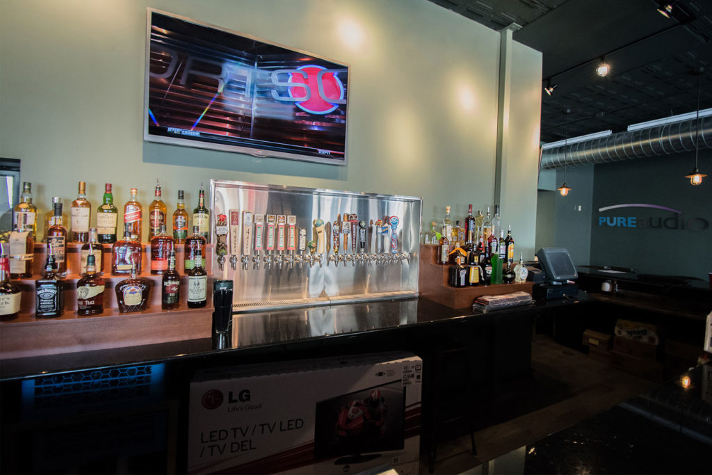Sports Center at your home bar Mounted TV above Beer Taps in Downtown Columbia Bar Commercial Audio and Video for Medical Offices and Restaurants and Bars and Retail Shops by Pure Audio