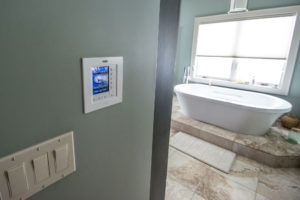 In-wall touch panel controls audio and video in home bathroom suite whole house automation with Pure Audio and Video in Columbia Missouri