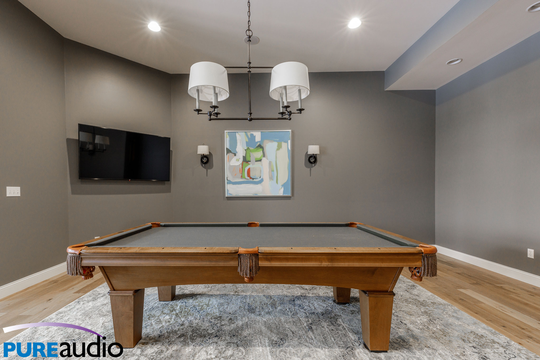 Columbia MO Custom Home with Wall Mounted Floating TV over Billiards Pool Table Game Room Man Cave by Pure Audio