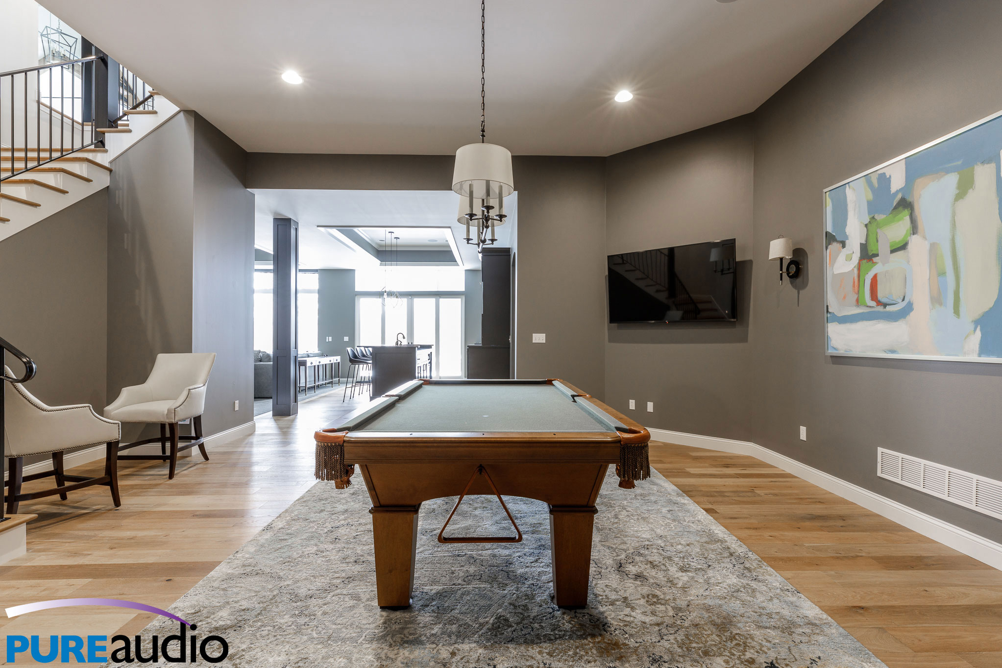 Columbia MO Custom Home with Wall Mounted Television Floating over Billiards Pool Table Game Room Man Cave by Pure Audio
